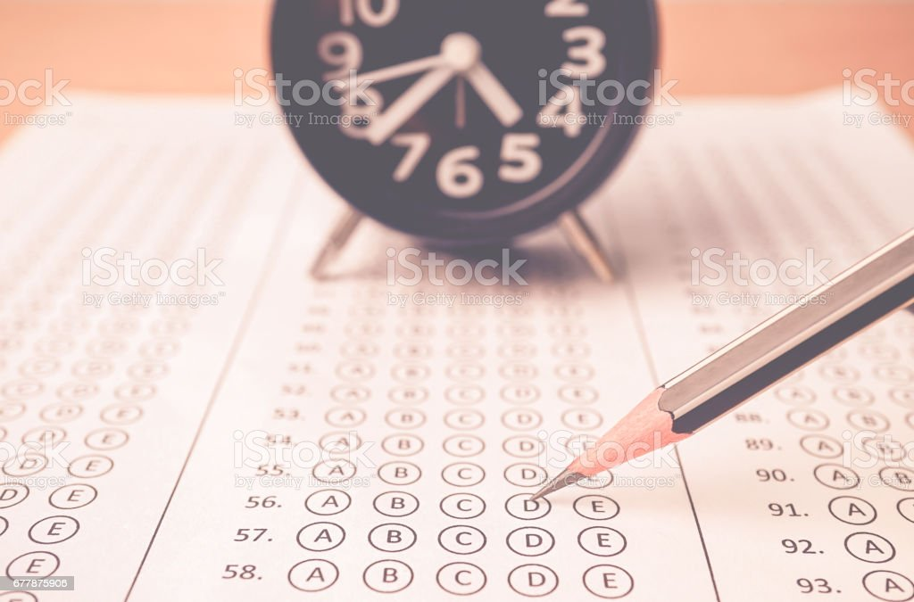 answer sheet , alarm clock and pencil for education concept royalty-free stock photo