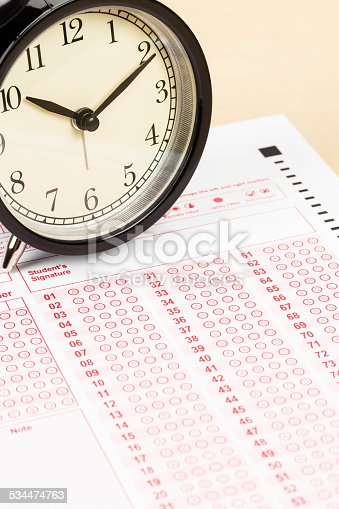 istock Answer sheet with alarm clock 534474763