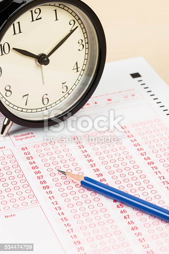 istock Answer sheet with pencil and alarm clock 534474759