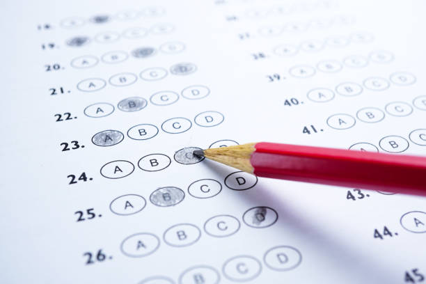 answer sheets with pencil drawing fill to select choice : education concept - exam stock pictures, royalty-free photos & images