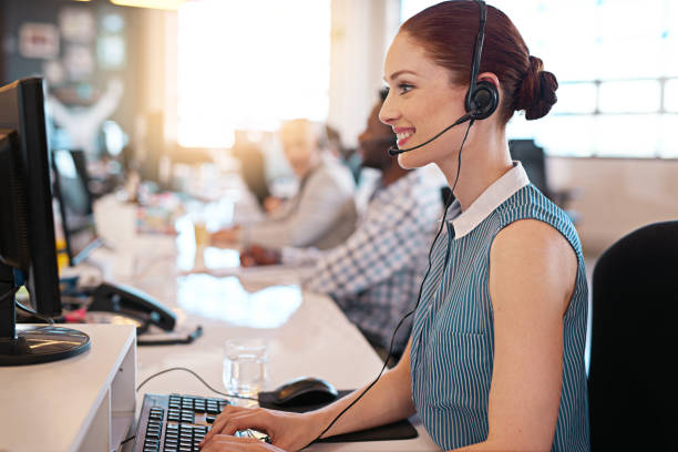 answering your call with a smile - call center stock photos and pictures