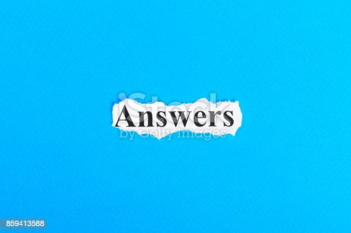 istock answers text on paper. Word answers on torn paper. Concept Image 859413588