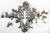 istock Ant or termite silhouette drawing made in ash 881475368