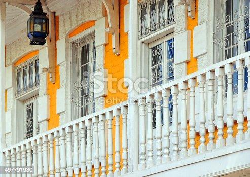 Antananarivo, Madagascar: elegant colonial balcony - yellow façade and white wooden railing - Rue Ramanantsoa - photo by M.Torres
