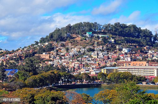 Antananarivo / Tananarive, Madagascar: Lake Anosy and above it one of the capital's 12 sacred hills, colline du fort Voyron - Maternité de Befelatanana on the right - photo by M.Torres