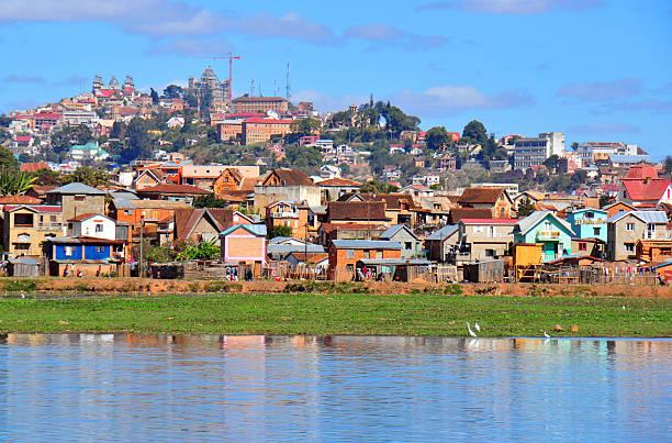 Antananarivo, Madagascar: Lake Masay, shanty town and palaces stock photo