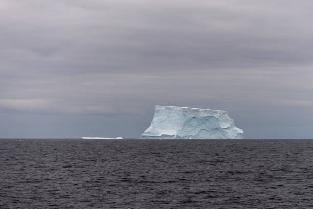 Antarctic landscape with iceberg at sea stock photo