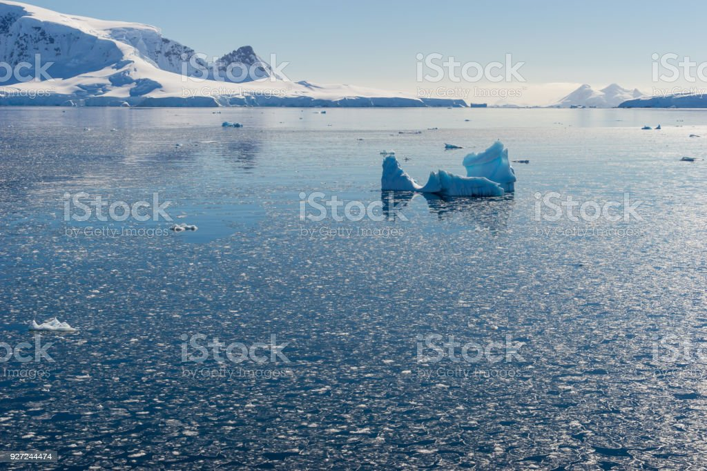 Antarctic Landscape with Icebergs and Mountains stock photo