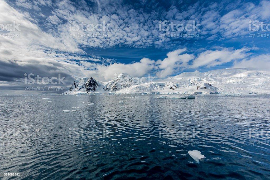 Antarctic peninsula covered in fresh snow stock photo