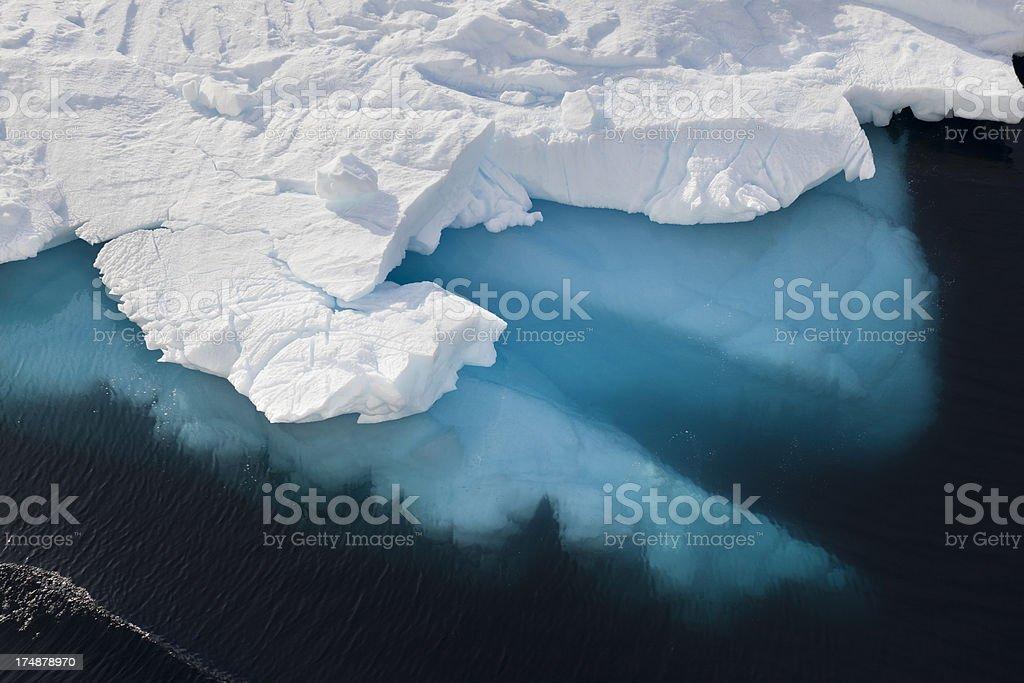 Antarctica blue iceberg floating stock photo