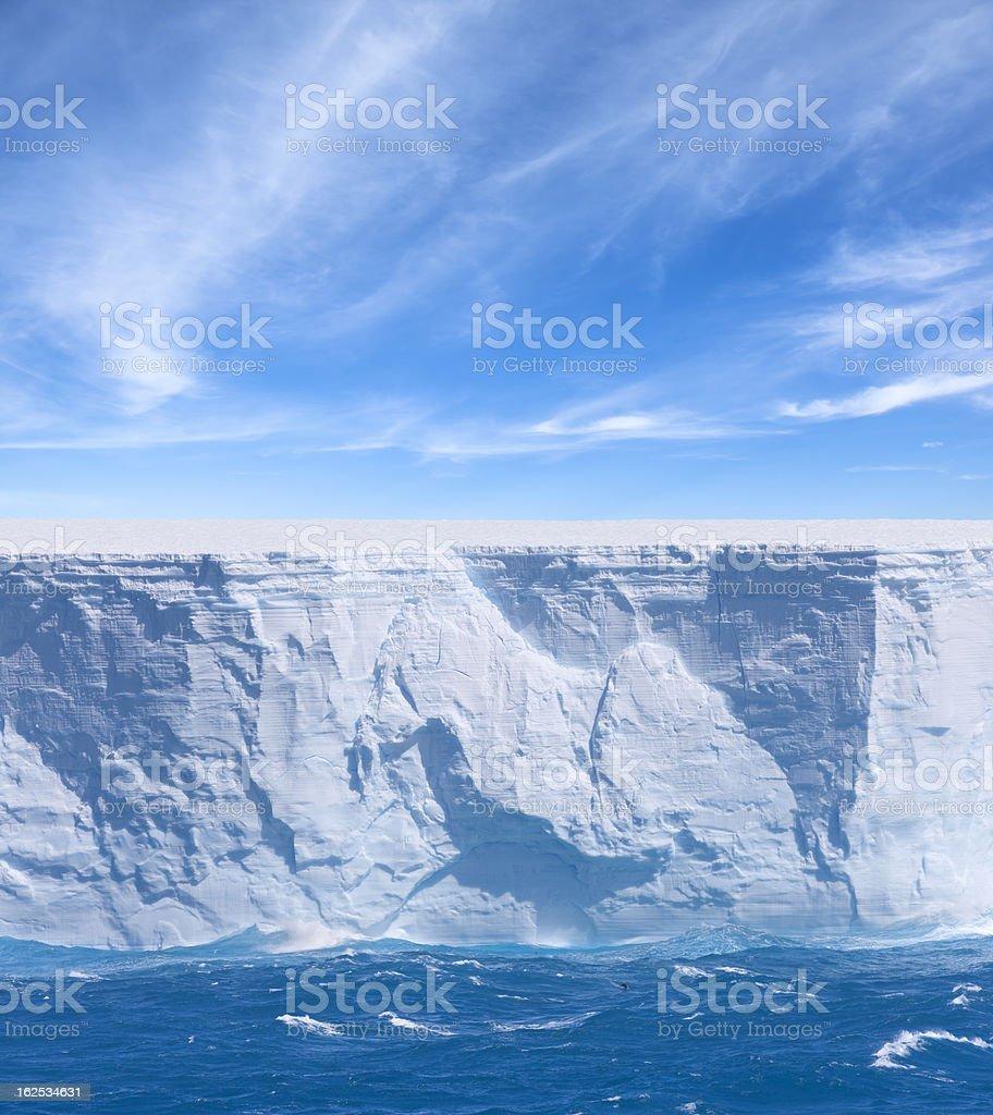 Antarctica bue iceberg floating stock photo