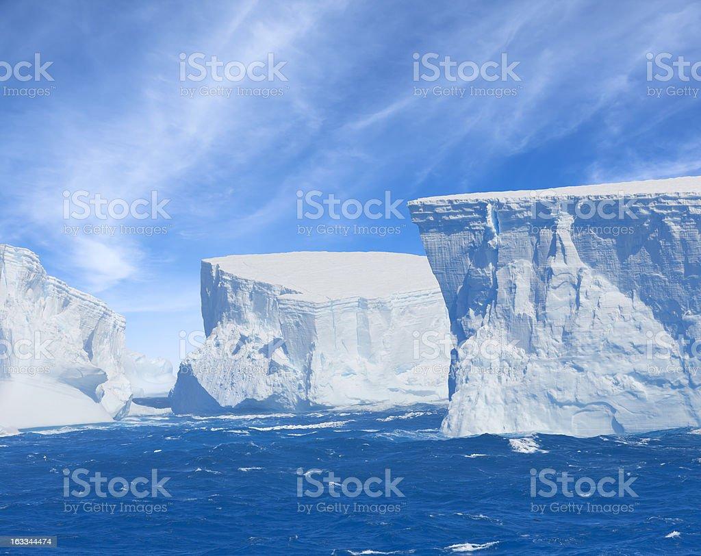 Antarctica giant blue iceberg floating stock photo