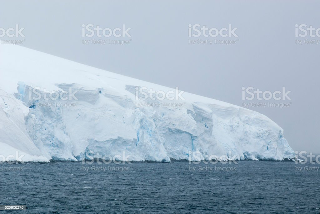 Antarctica in a cloudy day stock photo