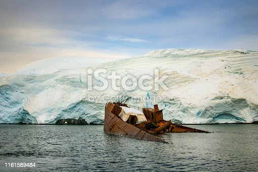 Antarctic scenery with ice, water and a whaling ship wreck