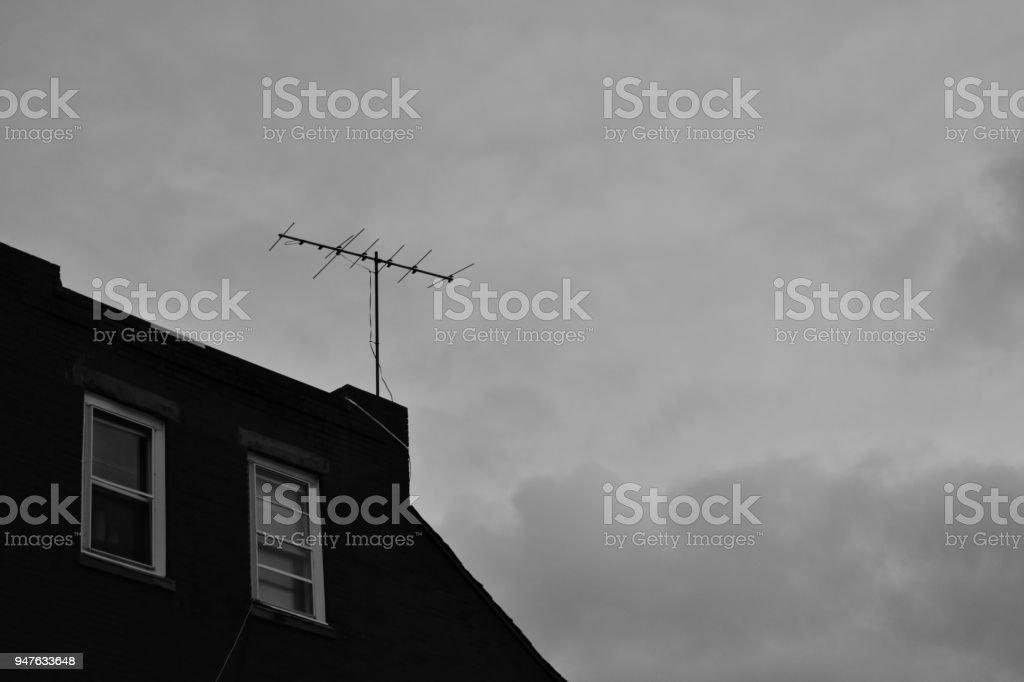 Antenna Against a Cloudy Sky stock photo