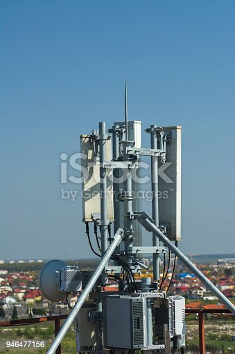1169777785istockphoto 4G antenna an the roof, blue sky background, network communications 946477156