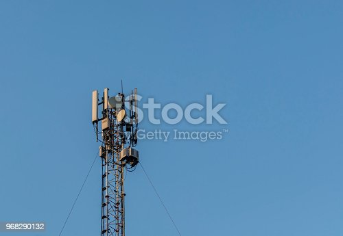 1169777785istockphoto 4G antenna an the roof, blue sky background 968290132