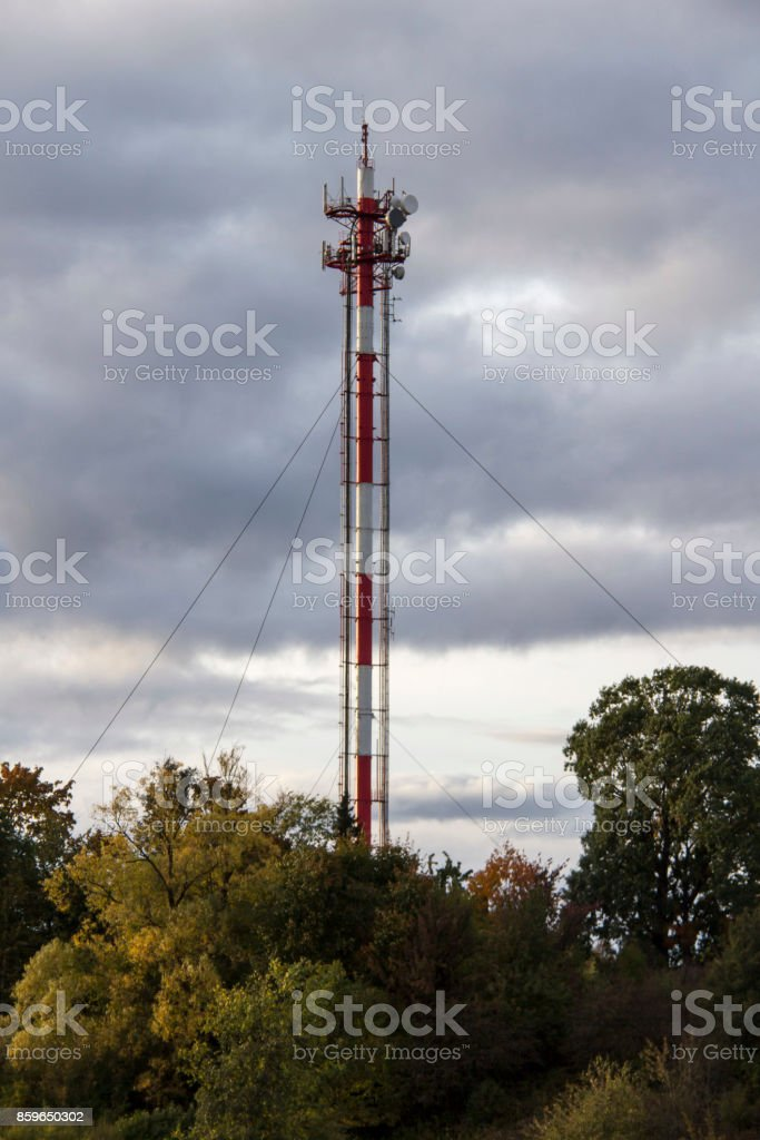 Antenna and cell phone towers on a mountaintop on a clear dayin autumn. stock photo