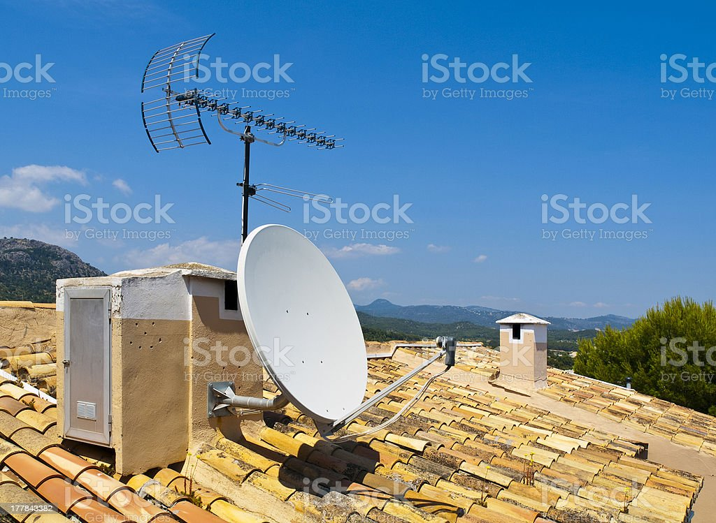 Antenna on a Tile Roof stock photo