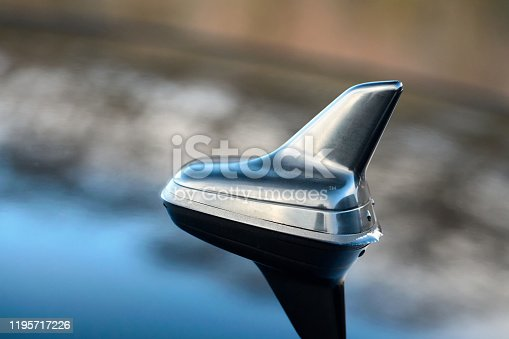 881639308 istock photo GPS antenna shark fin shape on a roof of german car for radio navigation system. 1195717226