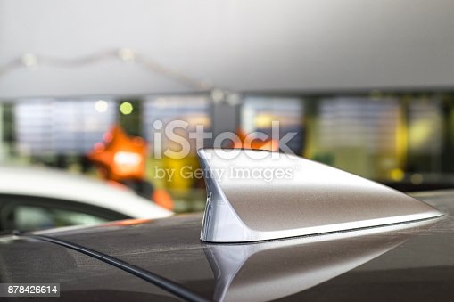 istock antenna shark fin white color on blurry backgorund. Using wallpaper or background.this car, automotive, transport image. 878426614