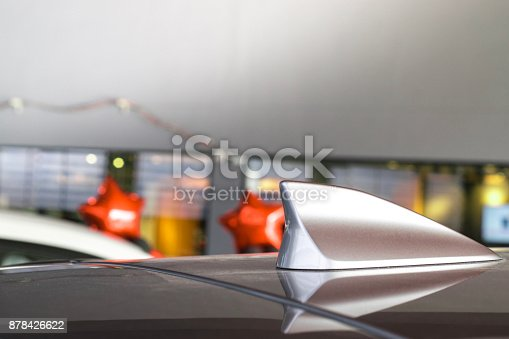 881639308istockphoto antenna shark fin white color on blurry backgorund. Using wallpaper or background.this car, automotive, transport image. 878426622