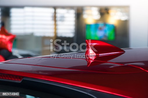 881639308istockphoto antenna shark fin white color on blurry backgorund. Using wallpaper or background.this car, automotive, transport image. 882414940