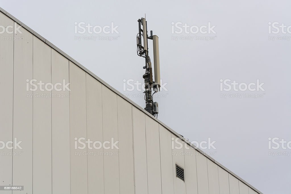 Antenna, telecommunications tower on a roof stock photo