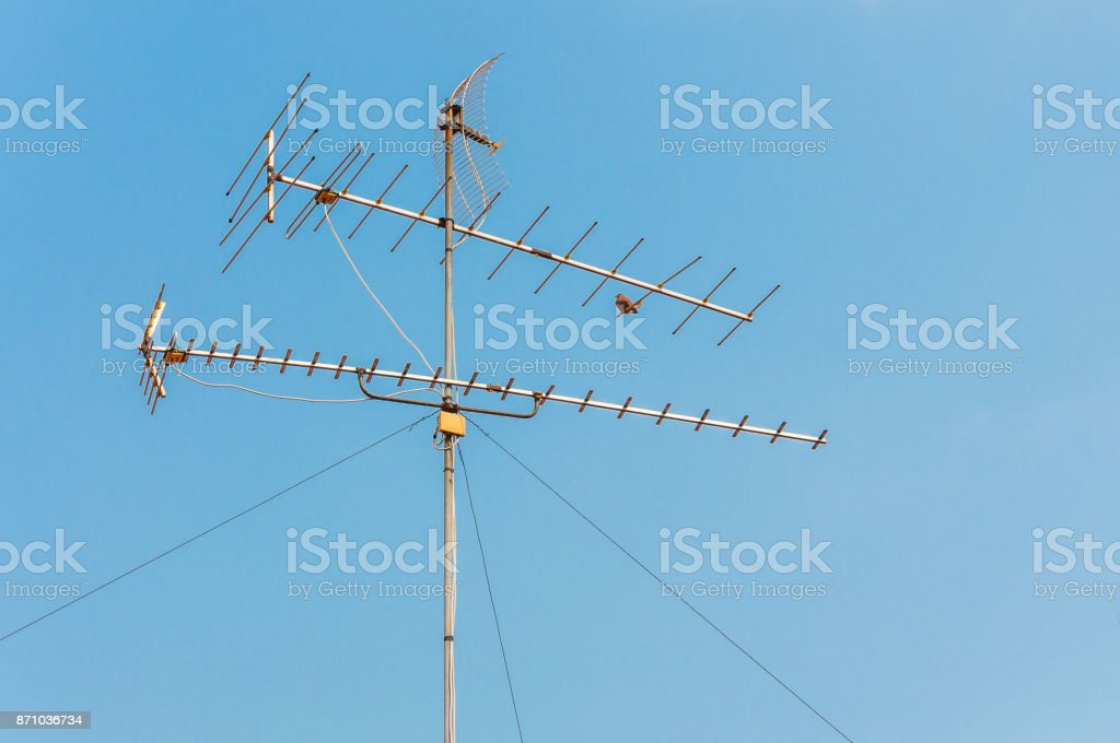 TV antenna with blue sky background stock photo