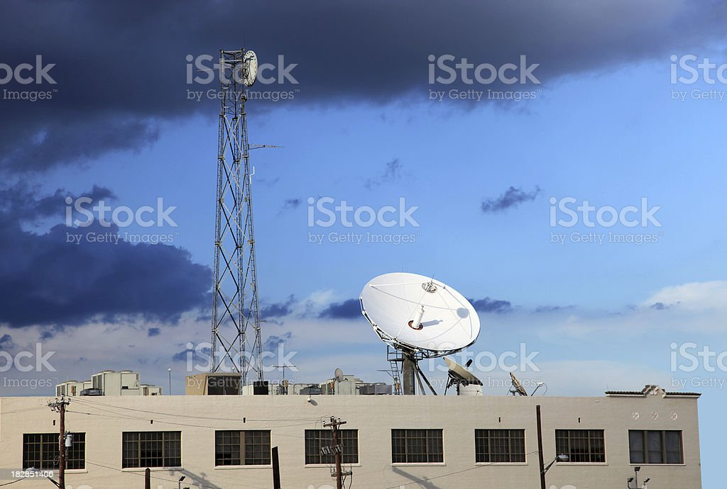 Antennas and satellite tower on top of the building royalty-free stock photo
