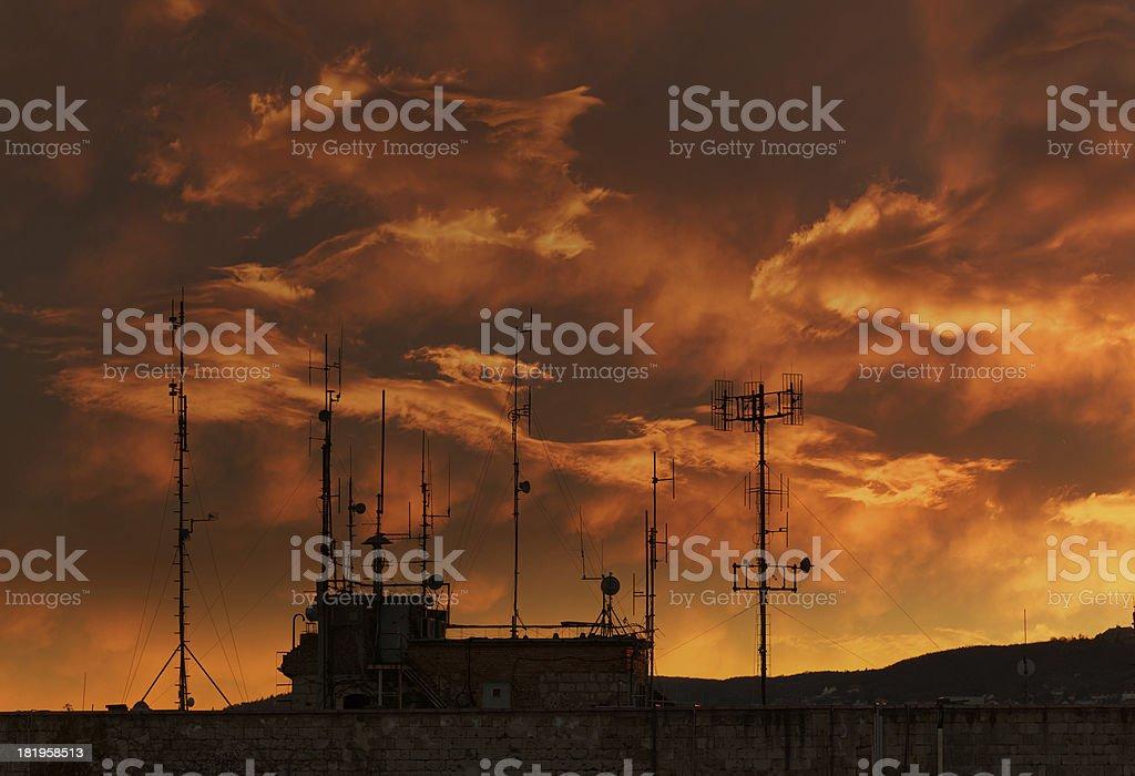 antennas at sunset royalty-free stock photo