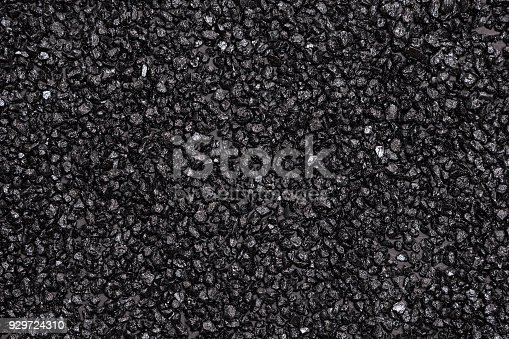 istock Anthracite black small stones texture 929724310