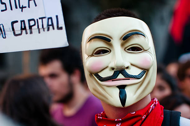 anti austerity protest - guy fawkes mask stock photos and pictures