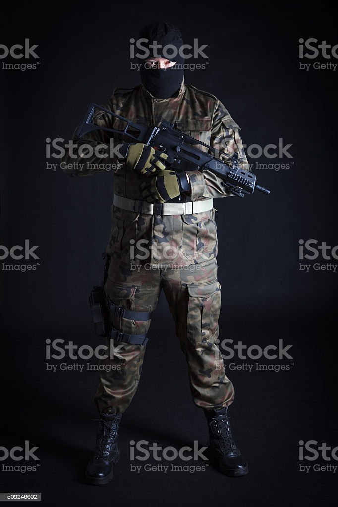 Anti terrorist standing with a gun, looking at camera royalty-free stock photo