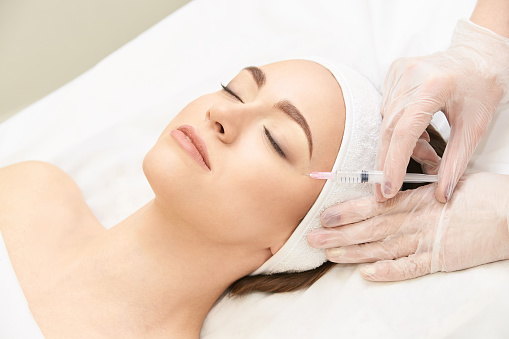 istock Anti wrinkle surgery. Beauty young woman injection. Facial treatment 1162453213