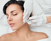 istock anti-aging face peel, procedure renewing skin , jet peeling 1125378463