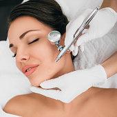 istock anti-aging face peel, procedure renewing skin , jet peeling 1130731611