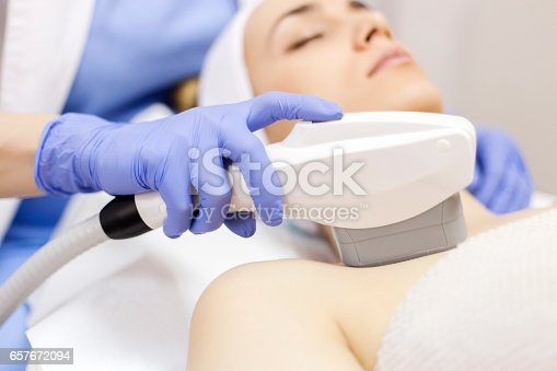 istock Anti-aging treatment, IPL laser, photo skin therapy 657672094