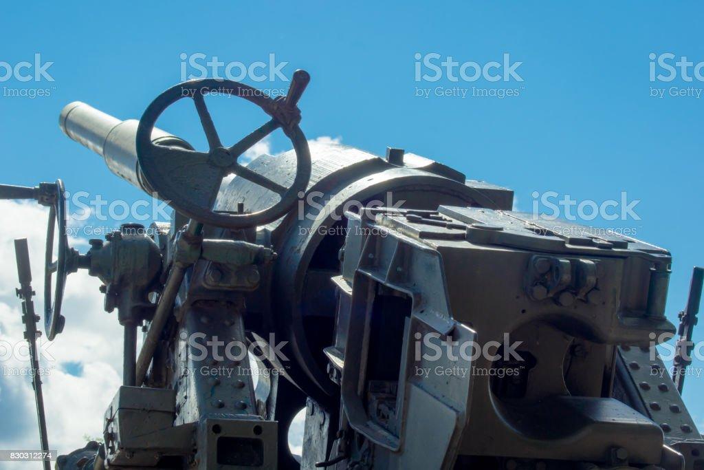 Anti-aircraft gun against the blue sky stock photo
