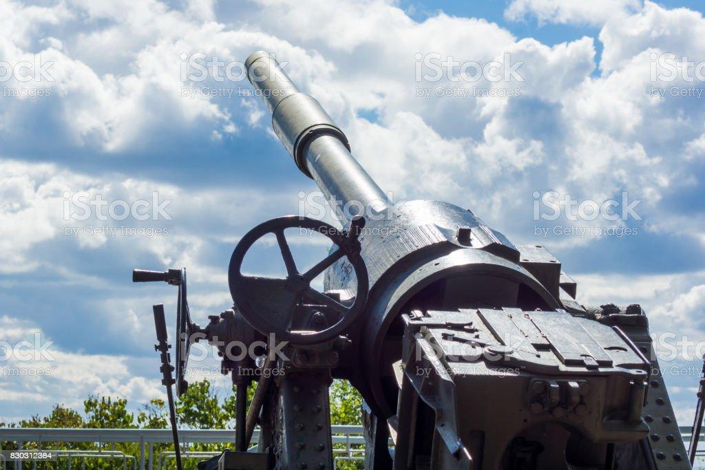 Antiaircraft gun against the sky stock photo