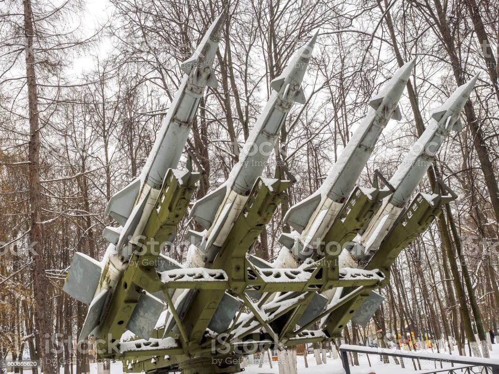 Anti-aircraft missiles bombarded day with snow in the park in winter. stock photo