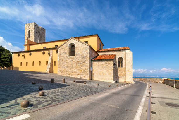 Antibes Cathedral and road along the sea in France. stock photo
