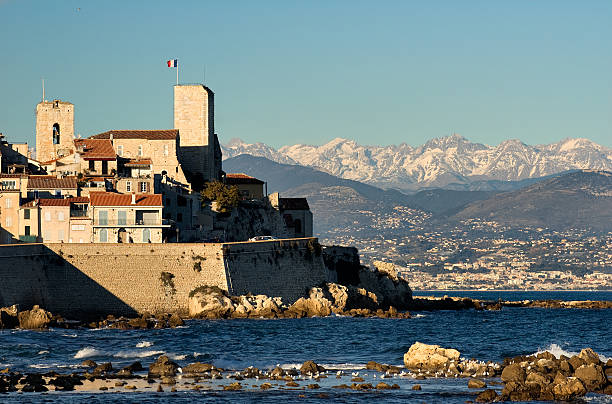 Antibes Citadel and the Alps stock photo