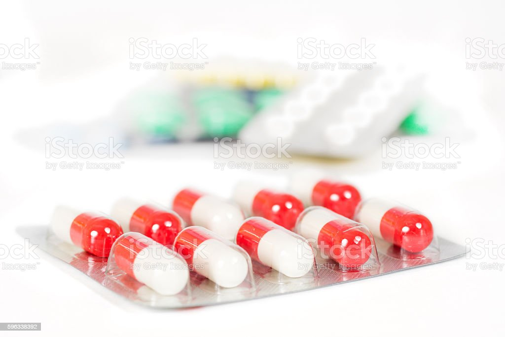 antibiotic in blister with blurred tablets Lizenzfreies stock-foto
