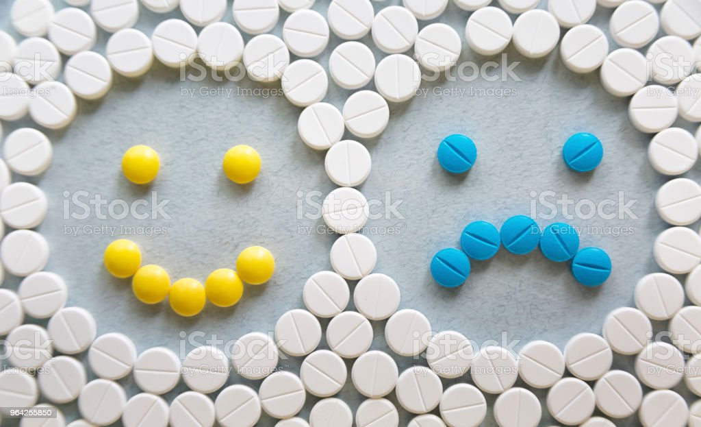 Antidepressants smile from pills symbol stock photo