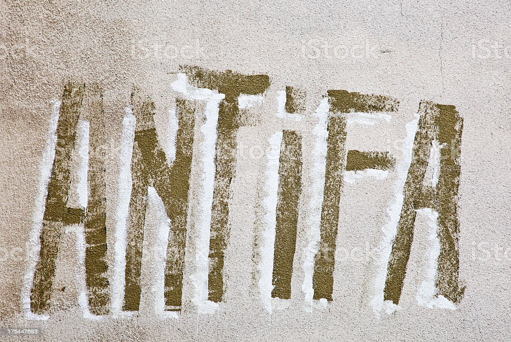 Antifa graffiti on wall. stock photo