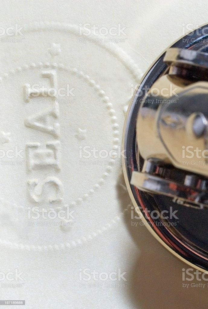 Antiforgery Official Notary or Corporate Original Document Embosssed Raised Seal stock photo