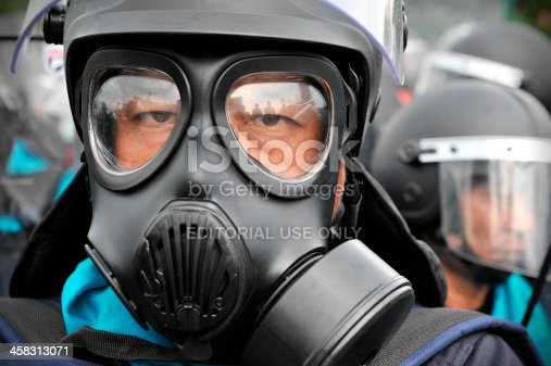 Bangkok, Thailand - November 24, 2012: Riot Police stand guard on Makhawan Bridge during a large anti-government rally organised by the nationalist Pitak Siam group.