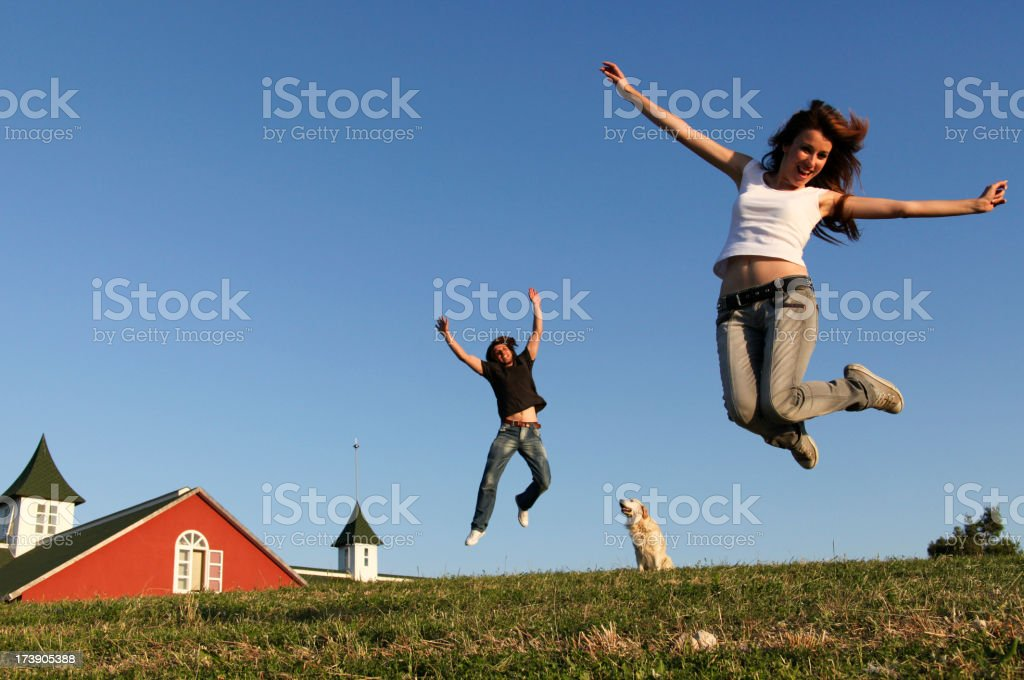 Anti-gravity couple celebrating the new home ownership royalty-free stock photo