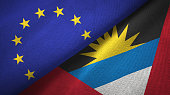 Antigua and Barbuda and European Union two flags together textile cloth, fabric texture